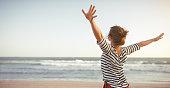 istock happy woman enjoying freedom with open hands on sea 909271750