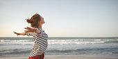 istock happy woman enjoying freedom with open hands on sea 910163142