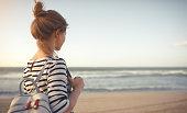 istock happy woman enjoying freedom with open hands on sea 921398802
