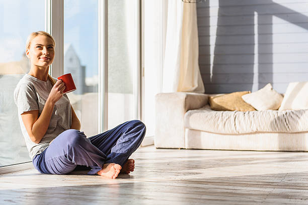 Happy woman enjoying homey morning stock photo