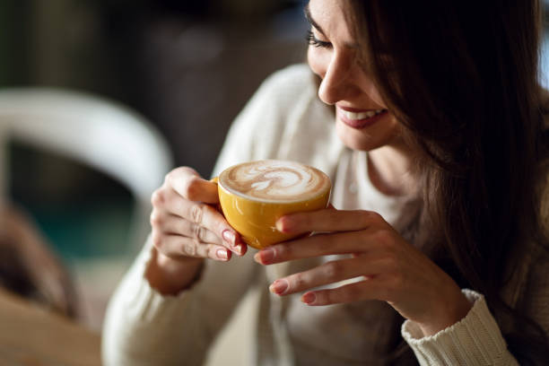 happy woman enjoying in cup of fresh coffee. - caffè foto e immagini stock