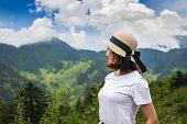istock Happy Woman Enjoying Nature on meadow on top of mountain 1142137991