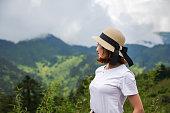 istock Happy Woman Enjoying Nature on meadow on top of mountain 1142137999