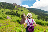 istock Happy Woman Enjoying Nature on meadow on top of mountain 1149187416