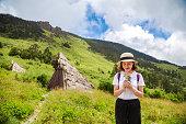 istock Happy Woman Enjoying Nature on meadow on top of mountain 1149187428