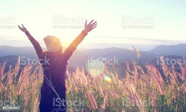 Happy woman enjoying nature on meadow on top of mountain with sunrise picture id897954642?b=1&k=6&m=897954642&s=612x612&h=qqcoks1qnj x2pyy0 k1gwczmgzpeu3xf0ssdf mkvu=