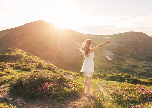 Happy woman enjoying the nature in the mountains