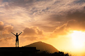 istock Happy woman enjoying the sunset 1089175210