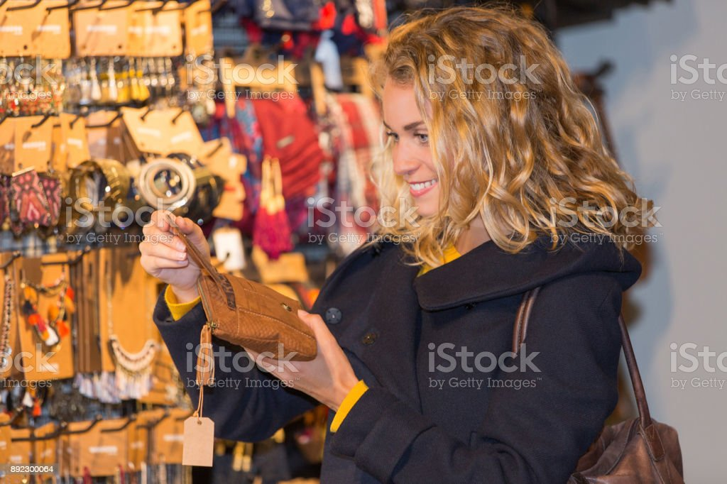 happy woman enjoys in clothing shop stock photo
