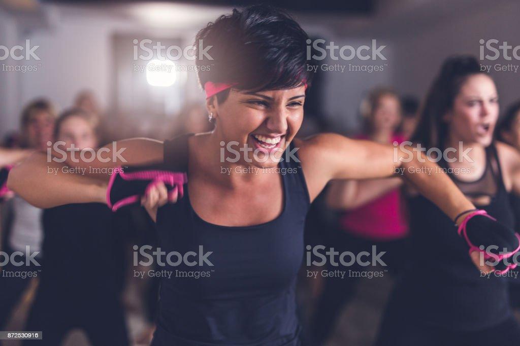 Happy woman exercising stock photo