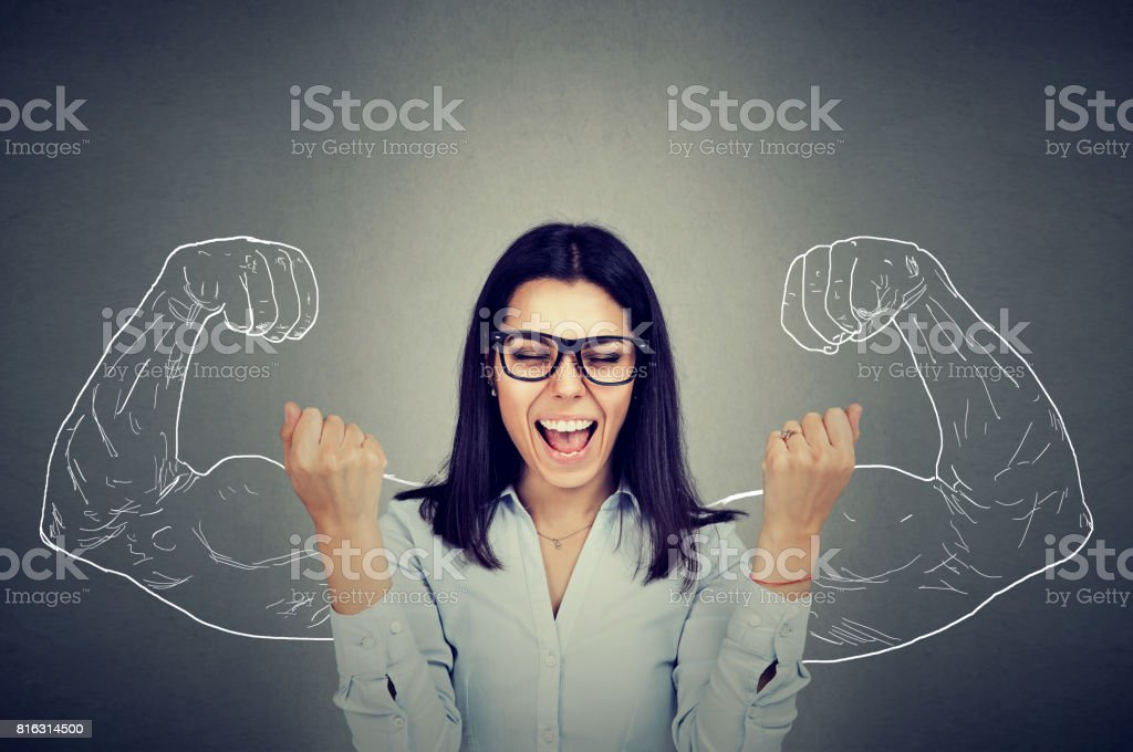 happy woman exults pumping fists celebrates success stock photo