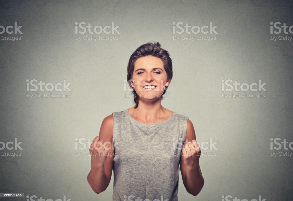 happy woman exults pumping fists ecstatic celebrates success foto stock royalty-free