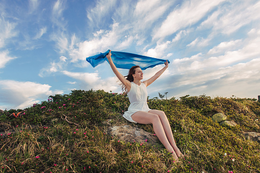 Happy woman feel freedom and enjoying the nature