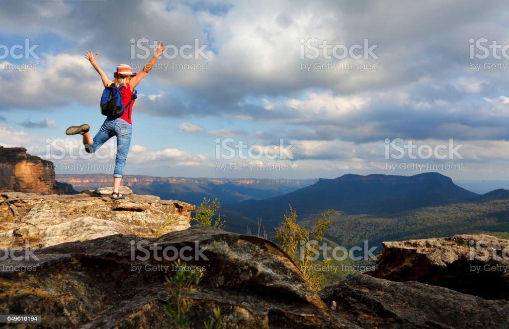 Happy Woman feeling elation, joy, success, accomplishment stock photo