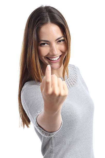 Happy woman gesturing beckoning stock photo