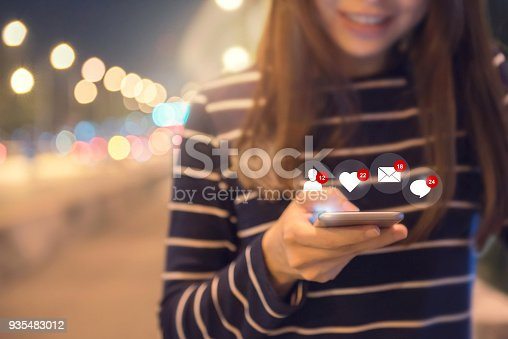 istock Happy woman hands using mobile smartphone with icon social media and social network. 935483012
