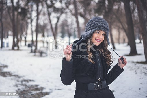 istock Happy woman have fun on the snow 913082352