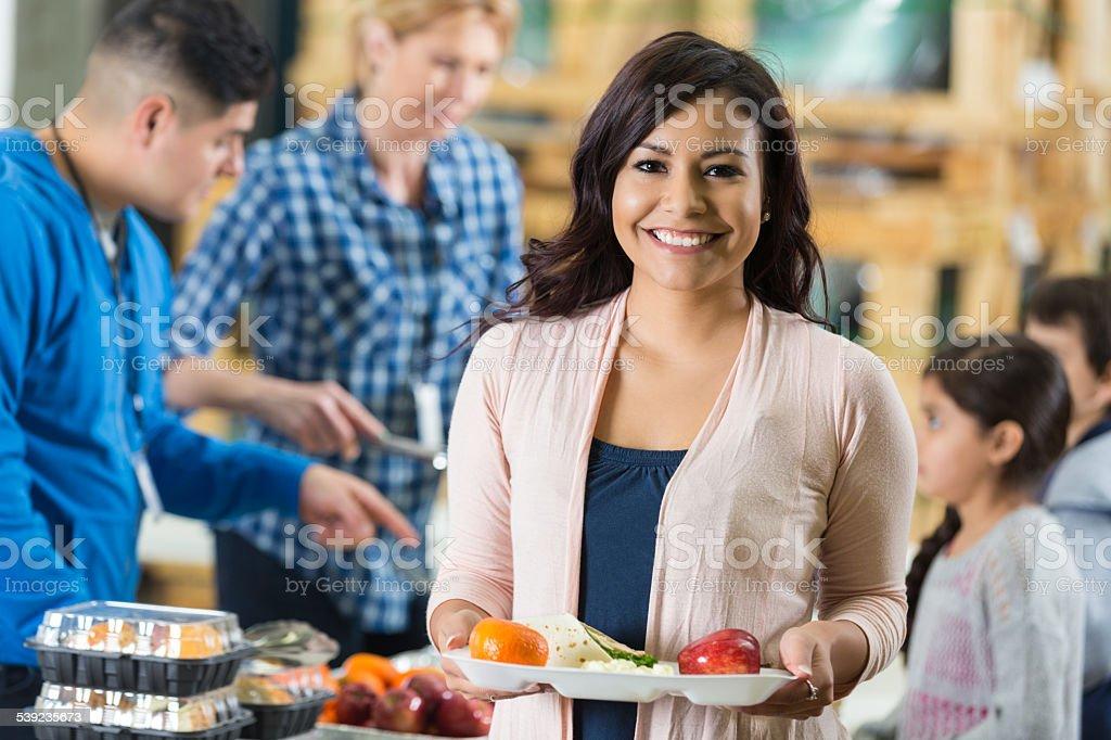 Happy woman having healthy meal at food bank royalty-free stock photo