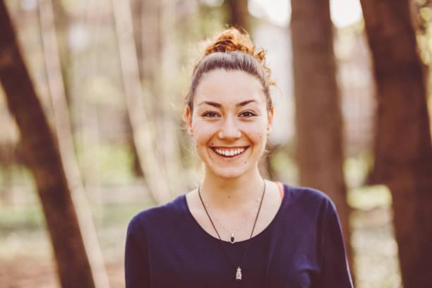 happy woman hiking - woman portrait forest foto e immagini stock