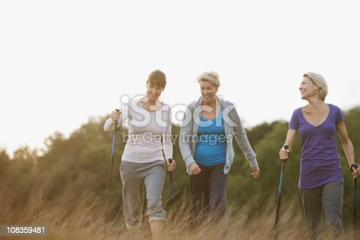 istock Happy woman hiking together outdoors 108359481