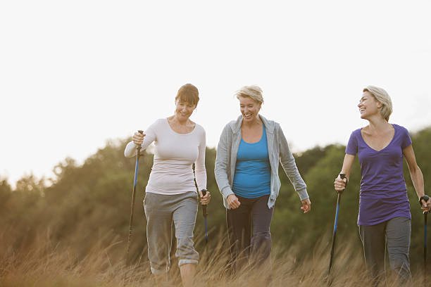 Happy woman hiking together outdoors stock photo