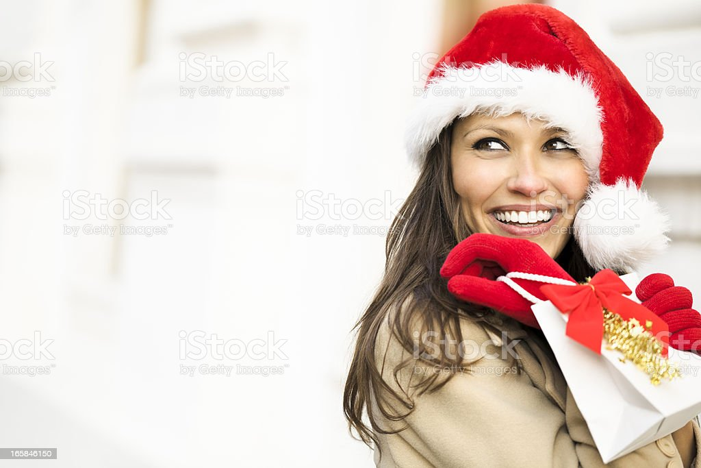 Happy woman holding a Christmas present royalty-free stock photo