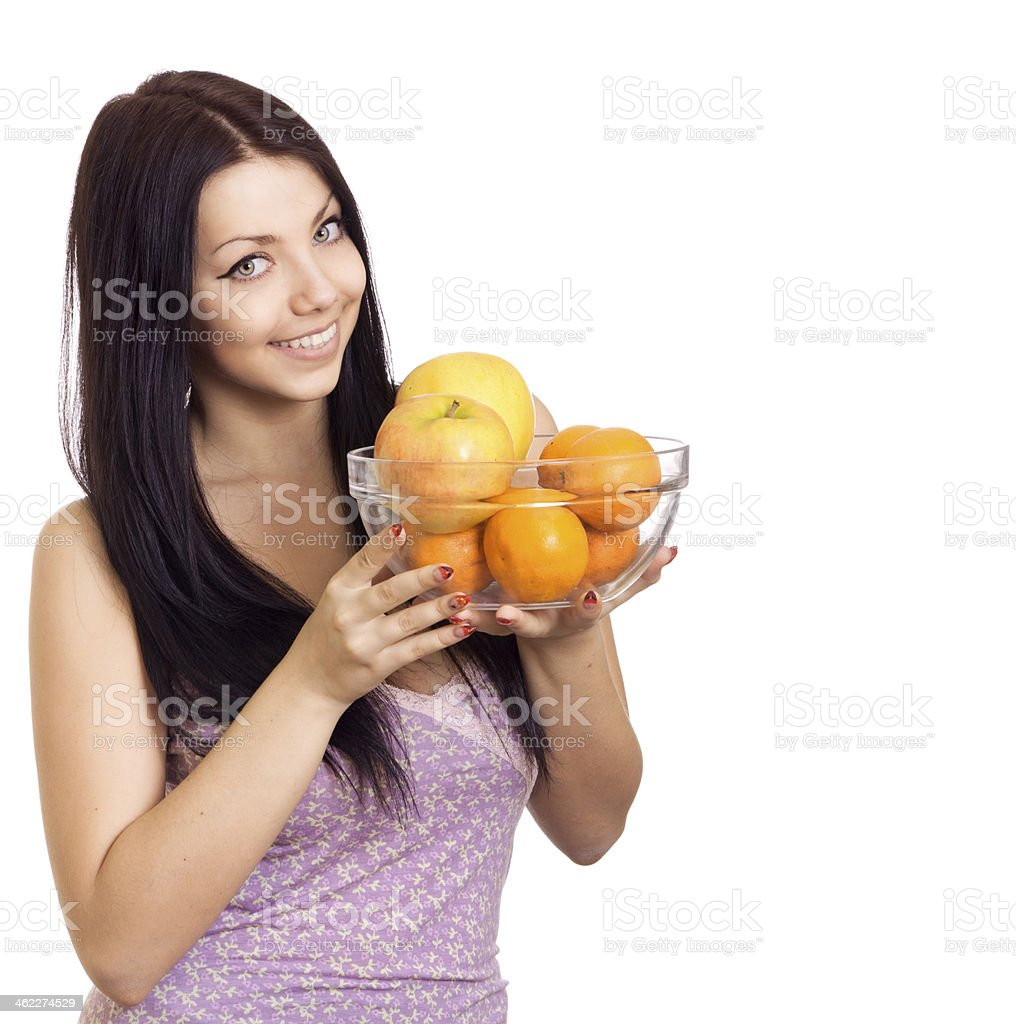 Happy woman holding a dish with fruits on white background royalty-free stock photo