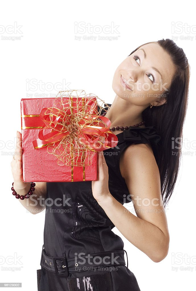 Happy woman holding a gift box royalty-free stock photo