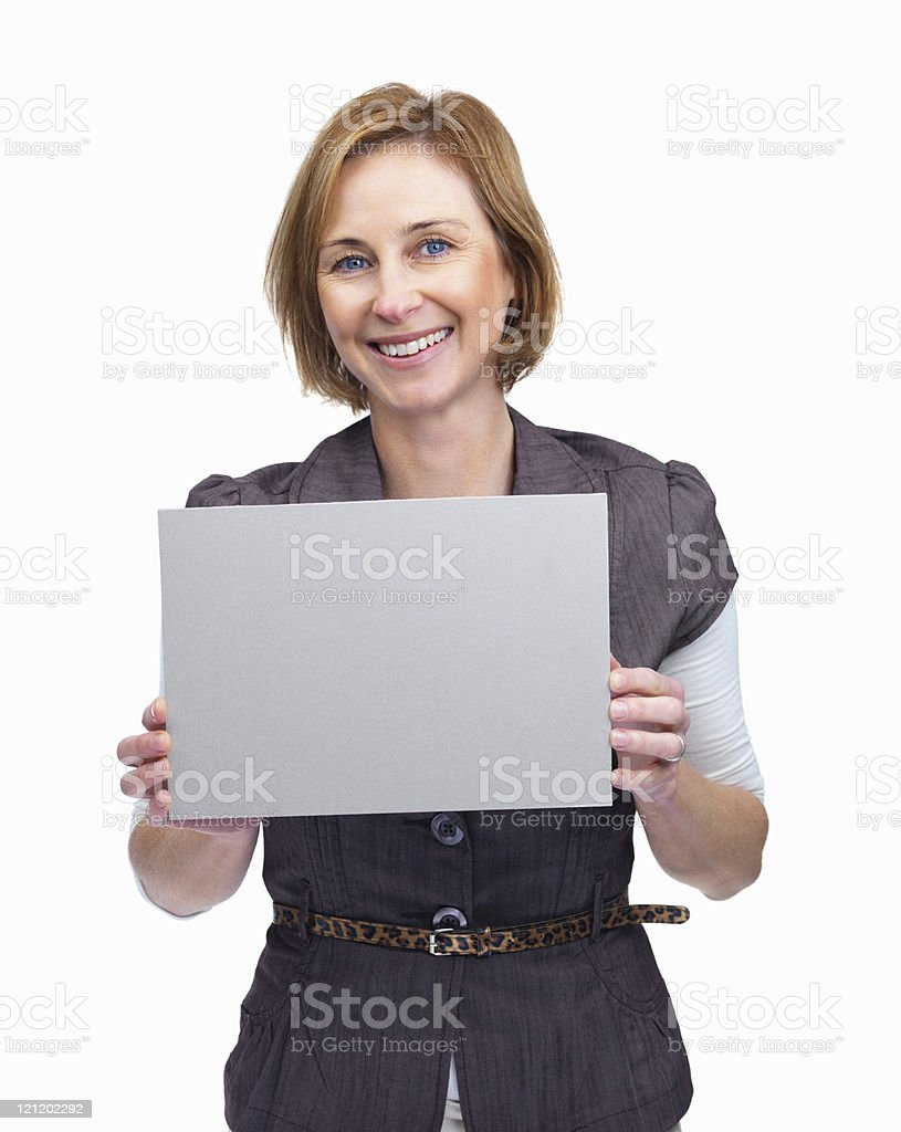 Happy woman holding blank billboard against white background royalty-free stock photo