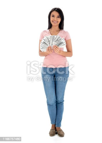 Happy Latin American woman holding cash in the studio and looking at the camera smiling - isolated over a white background