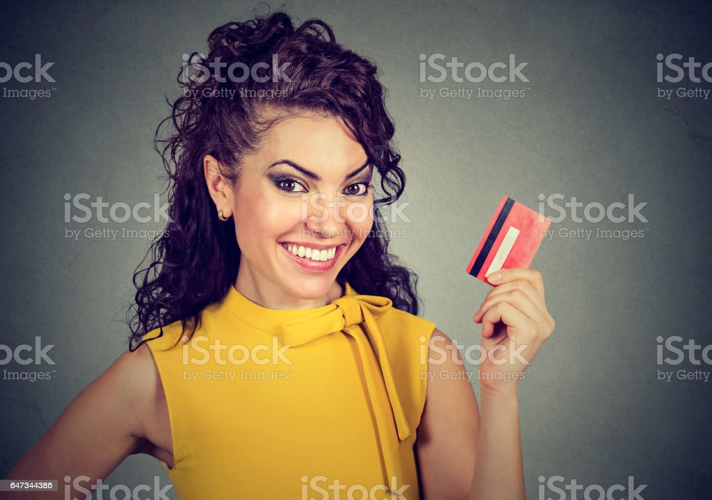 Happy woman holding credit card stock photo