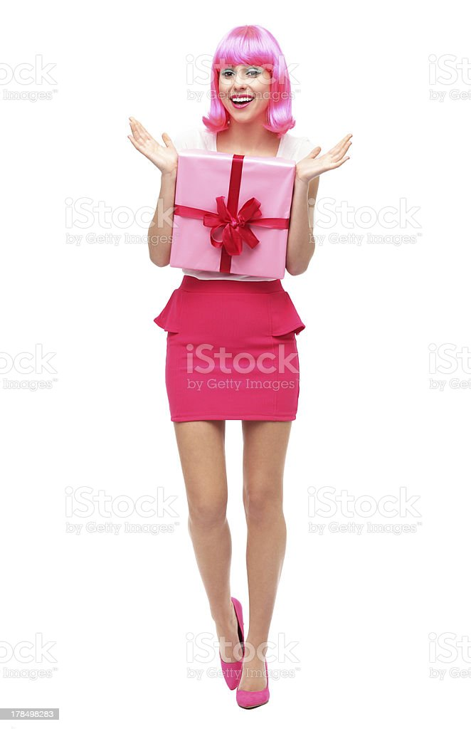 Happy woman holding gift royalty-free stock photo