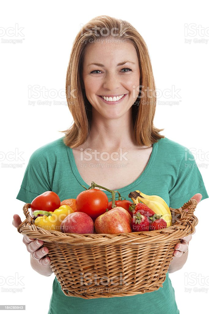 Happy Woman Holding Large Basket of Fruit royalty-free stock photo