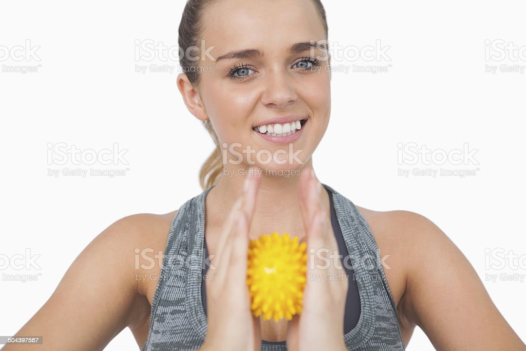 Happy woman holding massage ball between her hands stock photo