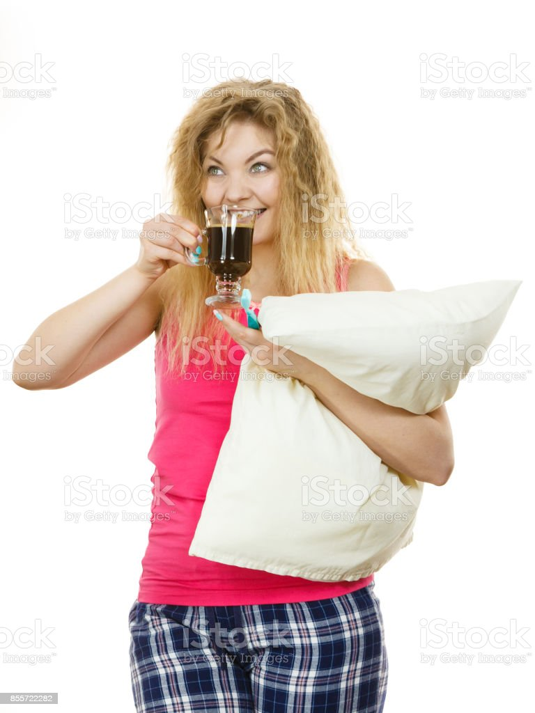 Happy woman holding toothbrush and coffee stock photo