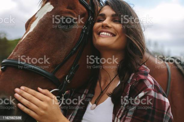 Happy woman hugging her horse picture id1162562339?b=1&k=6&m=1162562339&s=612x612&h=kneexv7p fau5d2xhpg3ohbalao7vfxutub 8sksw1s=