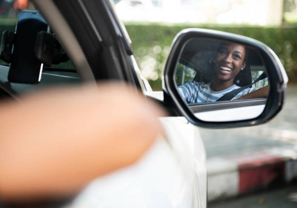 Happy woman in a car stock photo
