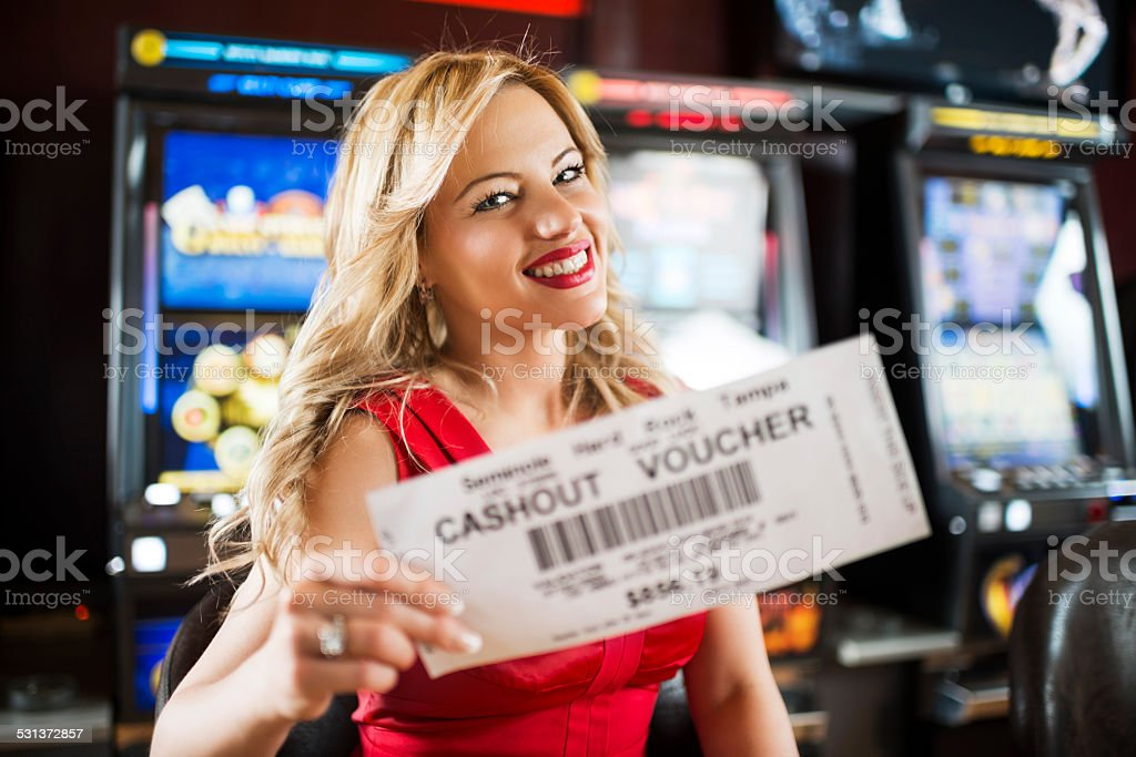 Happy woman in a casino. stock photo