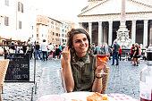 Young woman eating an Italian food