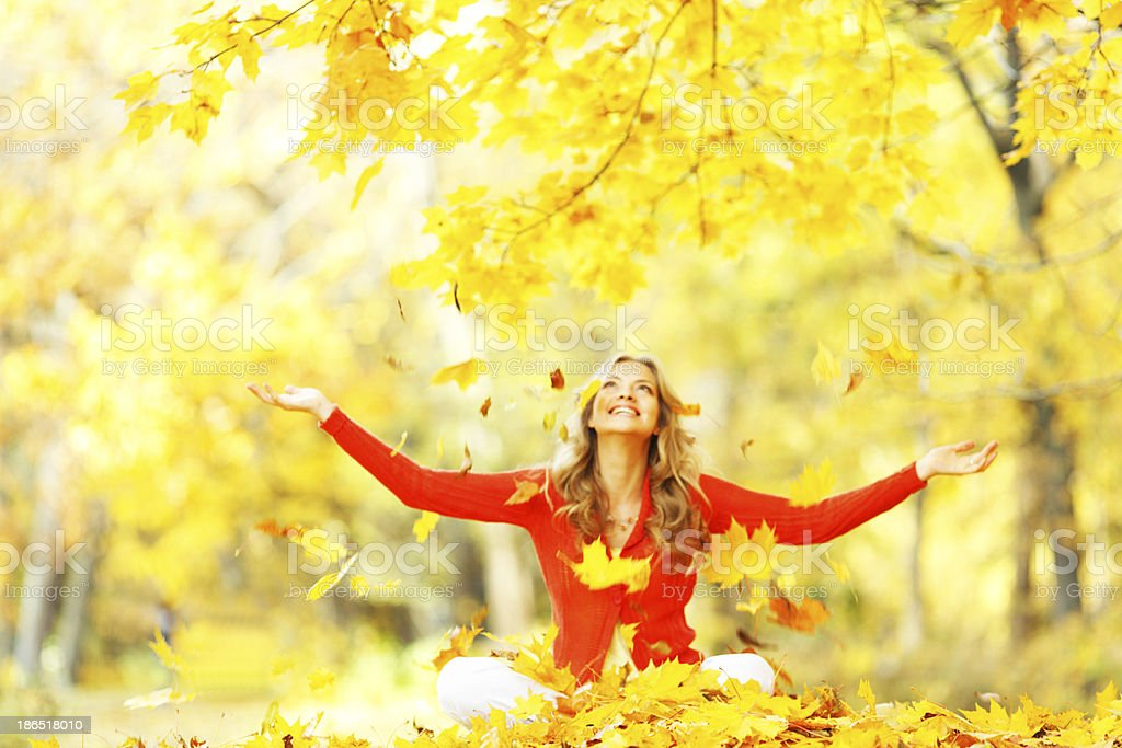 Happy woman in autumn park royalty-free stock photo