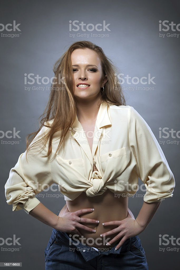 Happy woman in beige blouse and jeans royalty-free stock photo
