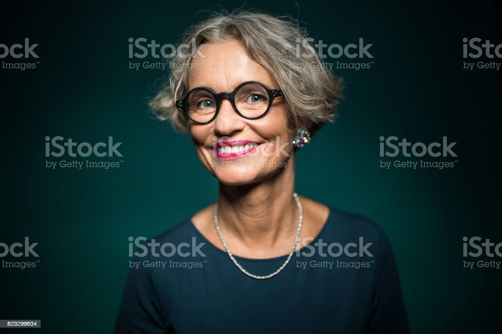 Happy Woman In Eyeglasses Against Green Background stock photo
