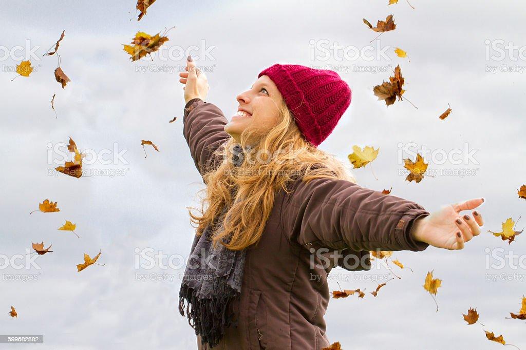 Happy woman in fall stock photo