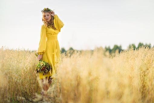 Happy woman in fields