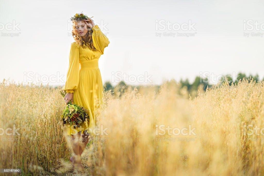 Happy woman in fields stock photo
