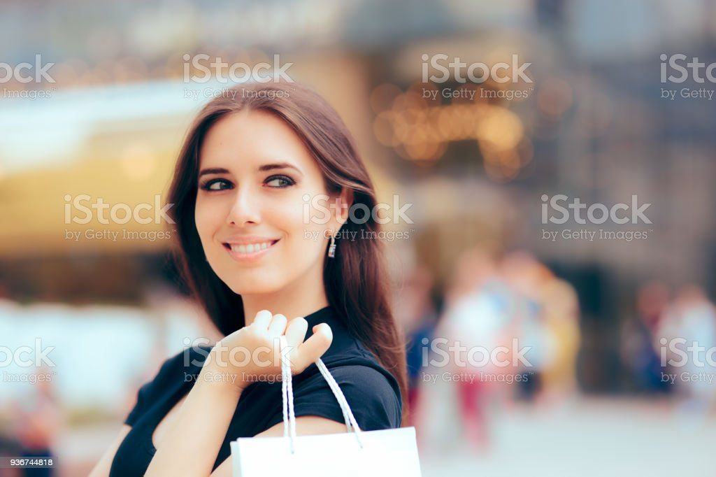 Happy Woman in Front of Shopping Mall Center stock photo