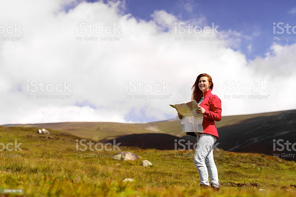 happy woman in mountain with her map royalty-free stock photo