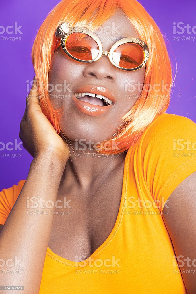 Happy woman in orange with wig stock photo
