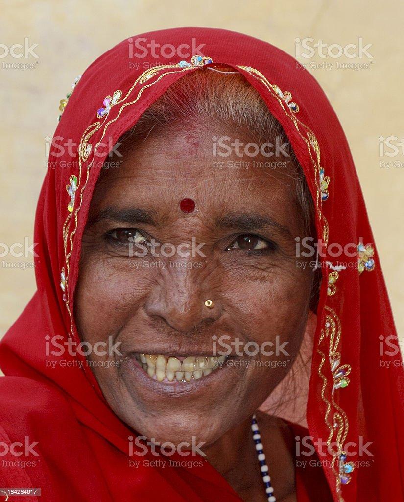 Happy Woman in red Sari Jaipur Rajasthan India stock photo