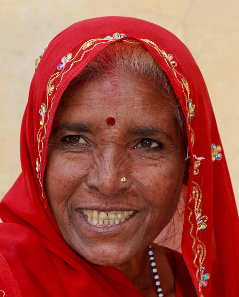 Happy Woman in red Sari Jaipur Rajasthan India stock photo